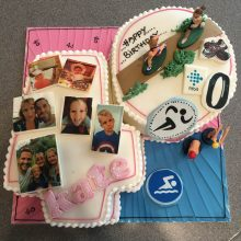 Personalised photo cake featuring multiple family photos. The cake is in the shape of a 4 and a 0.