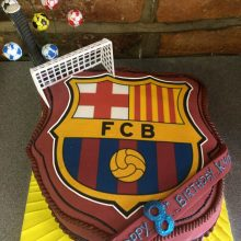 A personalised photo cake with a football badge photo on the front.