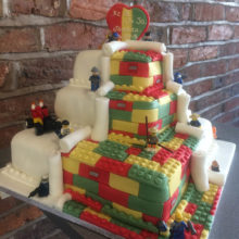 3 tiered wedding cake. The cake has icing Lego blocks. The cake is on display in a cake shop in Wolverhampton.