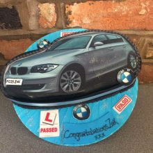 Personalised photo cake featuring a photo of a BMW. The cake is round and blue.